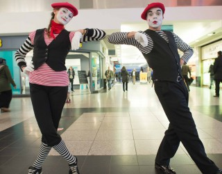 Ealing Broadway mime characters posing